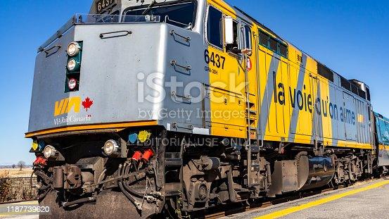 OTTAWA, ONTARIO, CANADA - October 26, 2019: A locomotive engineer waves from a VIA Rail train as it departs Fallowfield Station in Ottawa's Barrahaven neighbourhood.