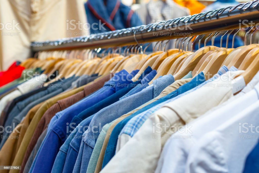 Rail of second-hand clothes on display at Old Spitalfields Market stock photo