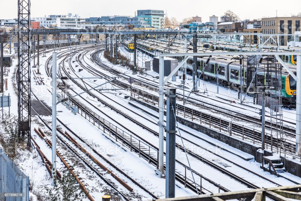 Rail tracks and trains covered by snow in London - Royalty-free Aerial View Stock Photo