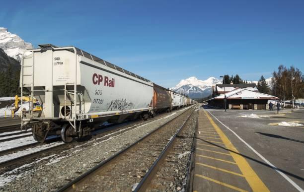 CP Rail Train at Banff Railway Station, Alberta Canada on a Sunny Autumn Afternoon stock photo