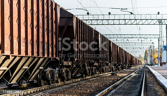 istock Rail transportation. Old freight car and railway track 1149912561