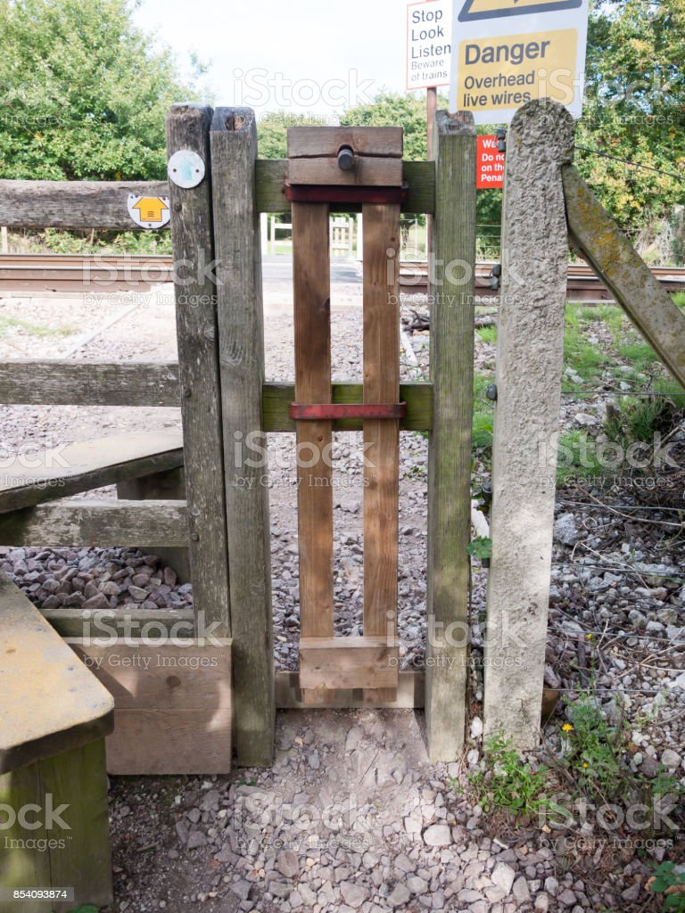 rail way train country crossing wooden fence stock photo