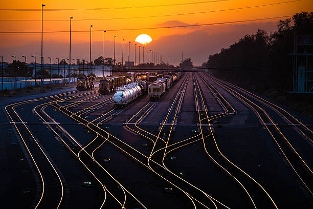 rail yard at sunset - godståg bildbanksfoton och bilder