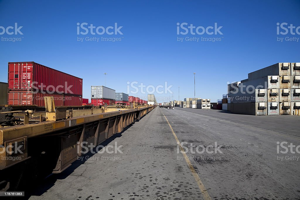 Rail yard with containers loaded onto train royalty-free stock photo
