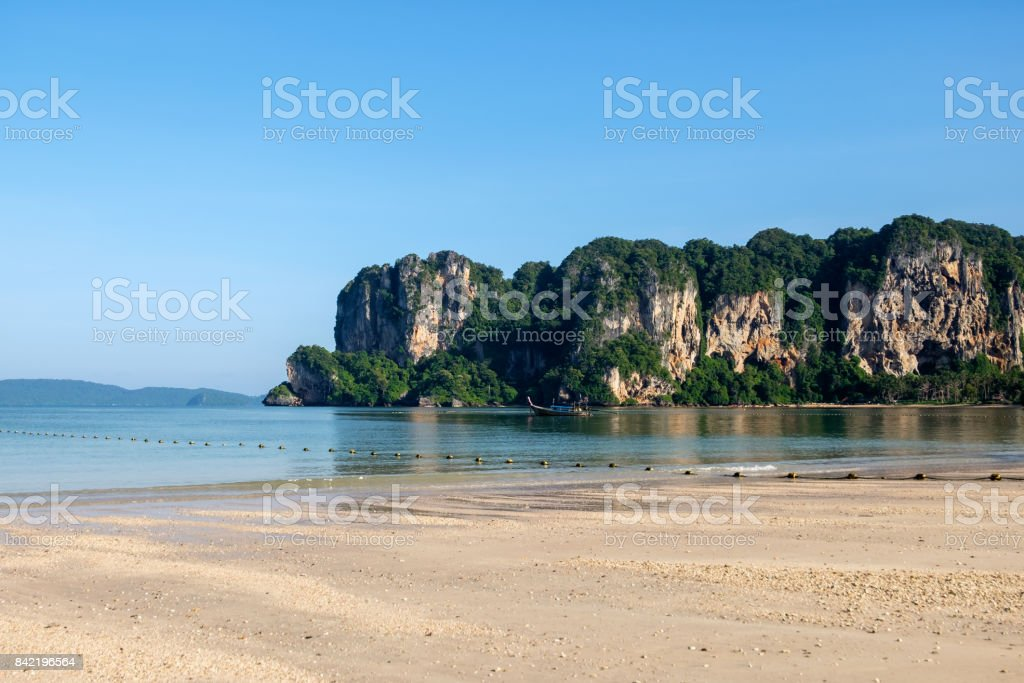 Railay west beach with mountain and long tail boat stock photo