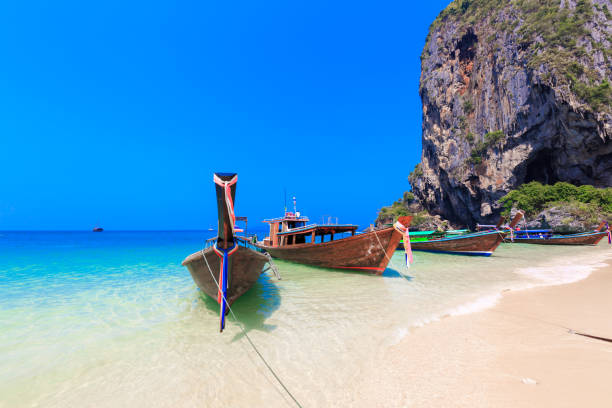 Railey beach, Long Tail Boats are getting ready to bring tourists to different island for swimming and snorkeling, Ao Nang, Krabi, Thailand. stock photo