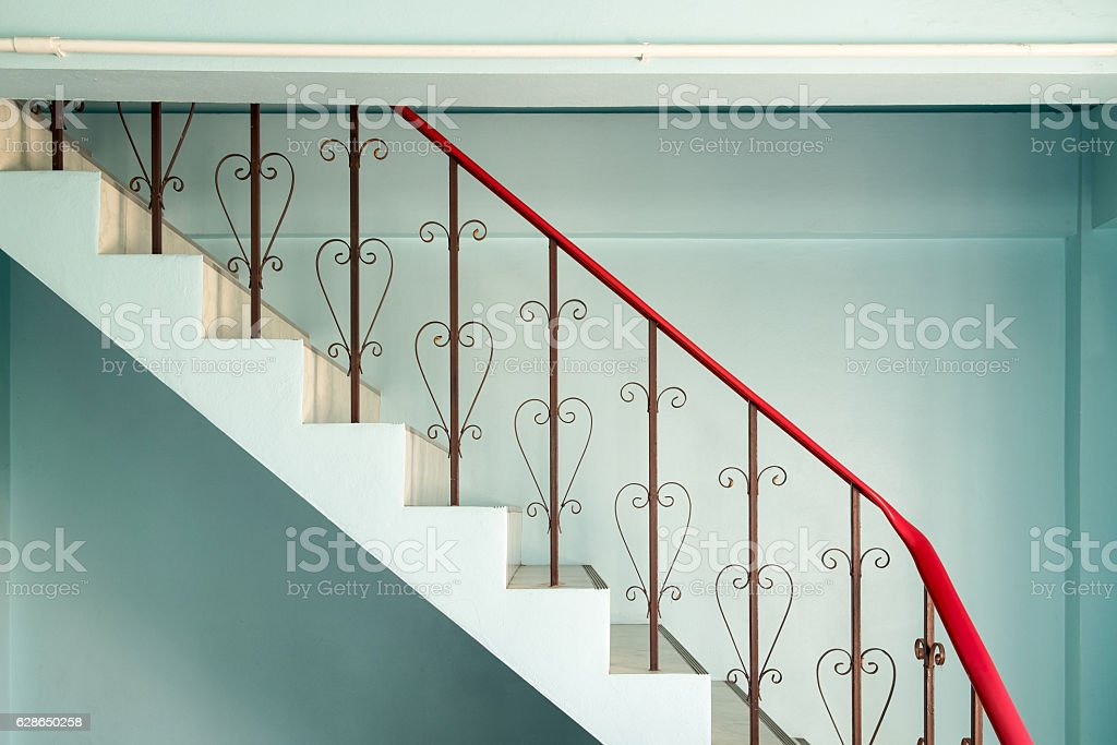 Railing banister stairs down curved steel stock photo