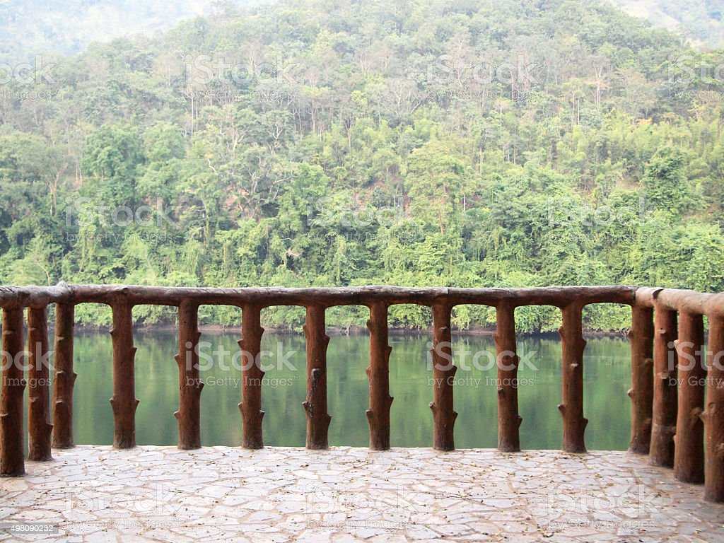 Railing of walkway beside river stock photo
