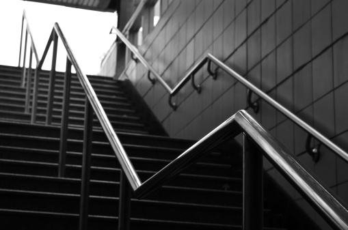 Railings and stairs in modern city in black and white.
