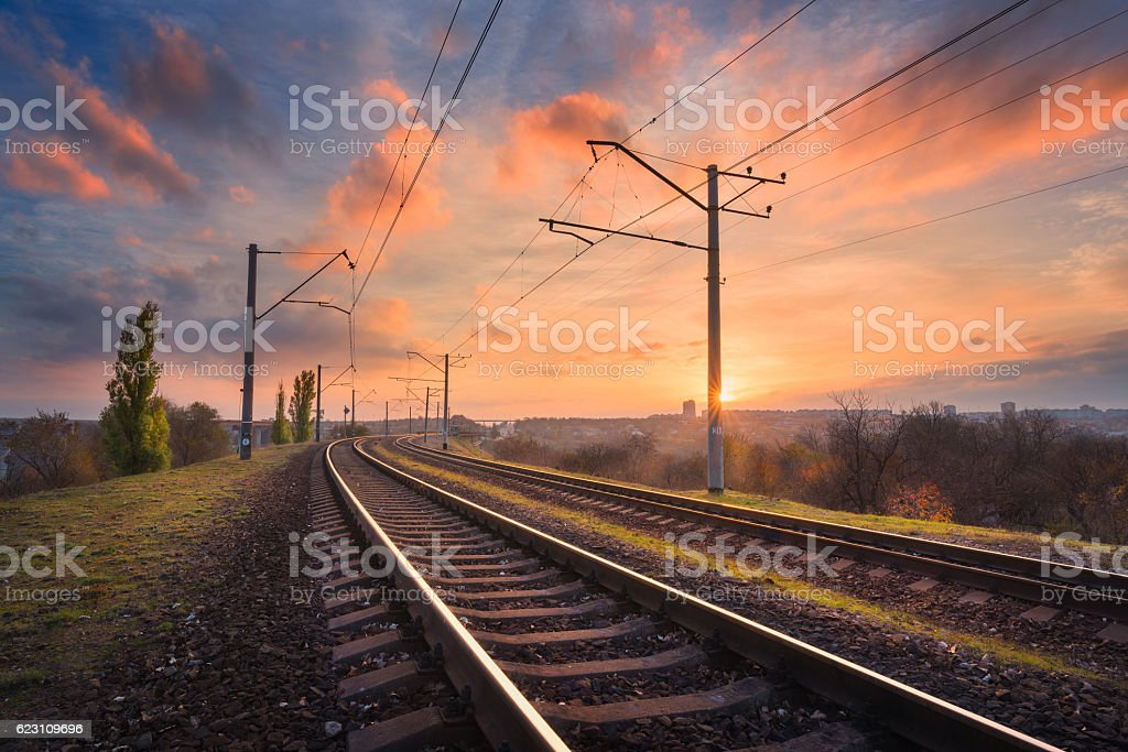 Railroad against beautiful sky at sunset. Industrial landscape stock photo