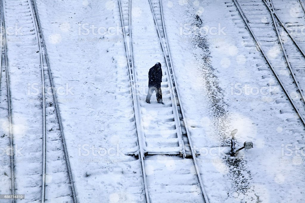 railroad and man in snow royalty-free stock photo