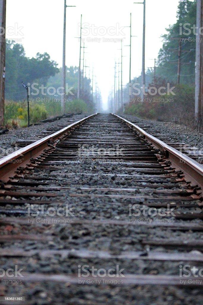 Railroad Before Dusk Fog Down the Tracks royalty-free stock photo