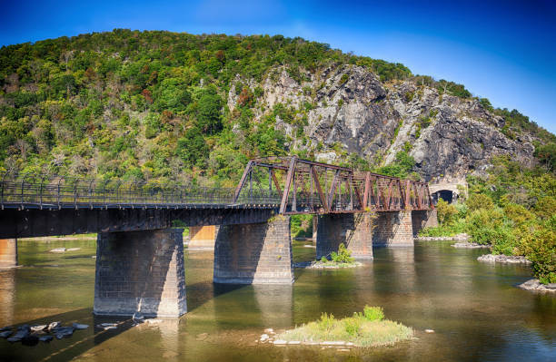 Railroad Bridge Across The Potomac In Harpers Ferry, West Virginia, USA Bridge from Harpers Ferry, West Virginia railway bridge stock pictures, royalty-free photos & images