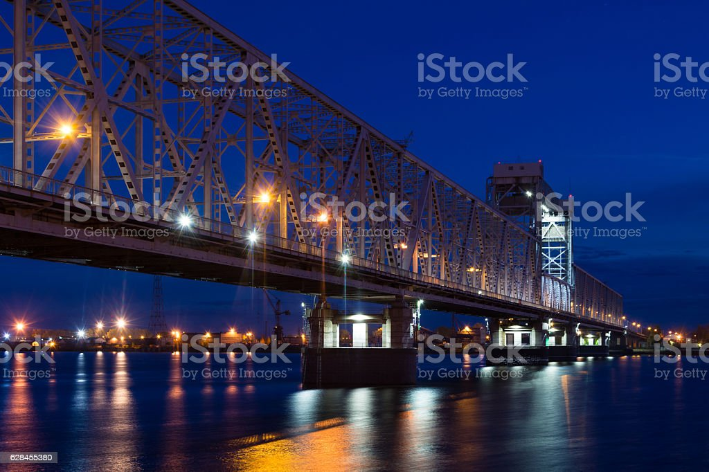 Railroad bridge in Arkhangelsk, Russia at night stock photo
