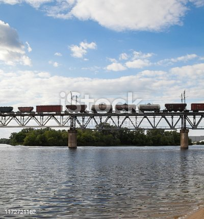 Petrivskiy railroad bridge in Kyiv (Ukraine) across the Dnieper. Freight train going on the bridge.