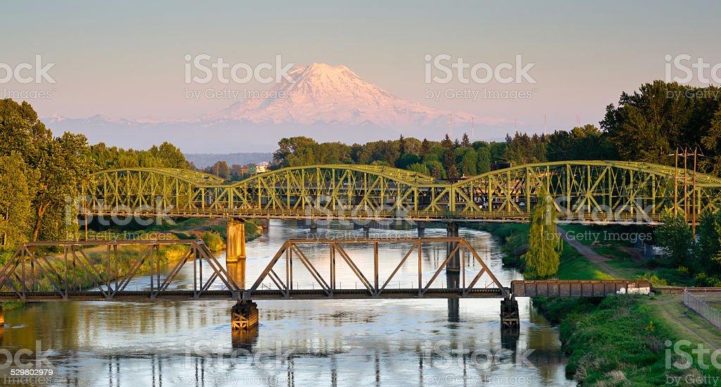 Railroad Car Bridges Puyallup River Mt. Rainier Washington stock photo