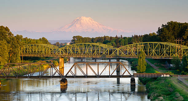 Railroad Car Bridges Puyallup River Mt. Rainier Washington The Puyallup River meanders down from the glaciers on Mount Rainier under bridges through cities on it's way to Puget Sound pierce county washington state stock pictures, royalty-free photos & images