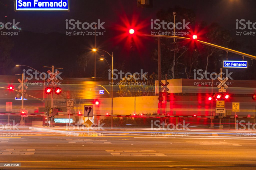Railroad Crossing During The Night With Motion Gates Stock