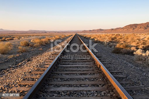 Railroad tracks and crossing in the California desert