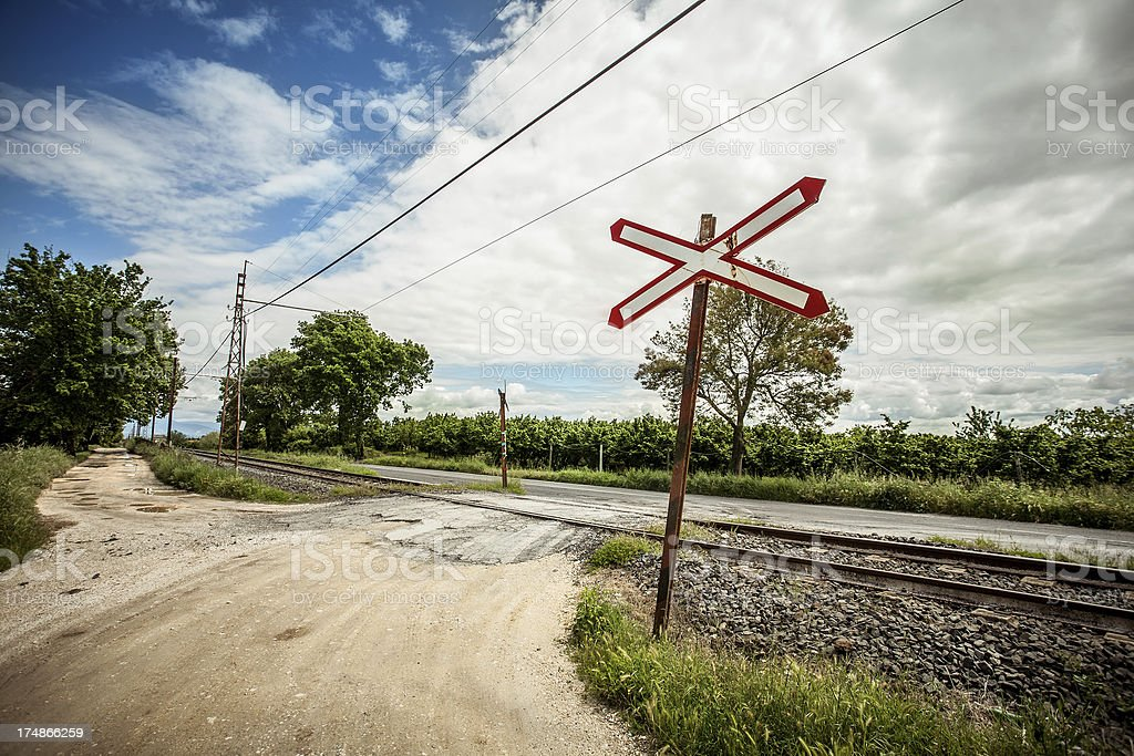 Railroad Crossing in Old Style royalty-free stock photo