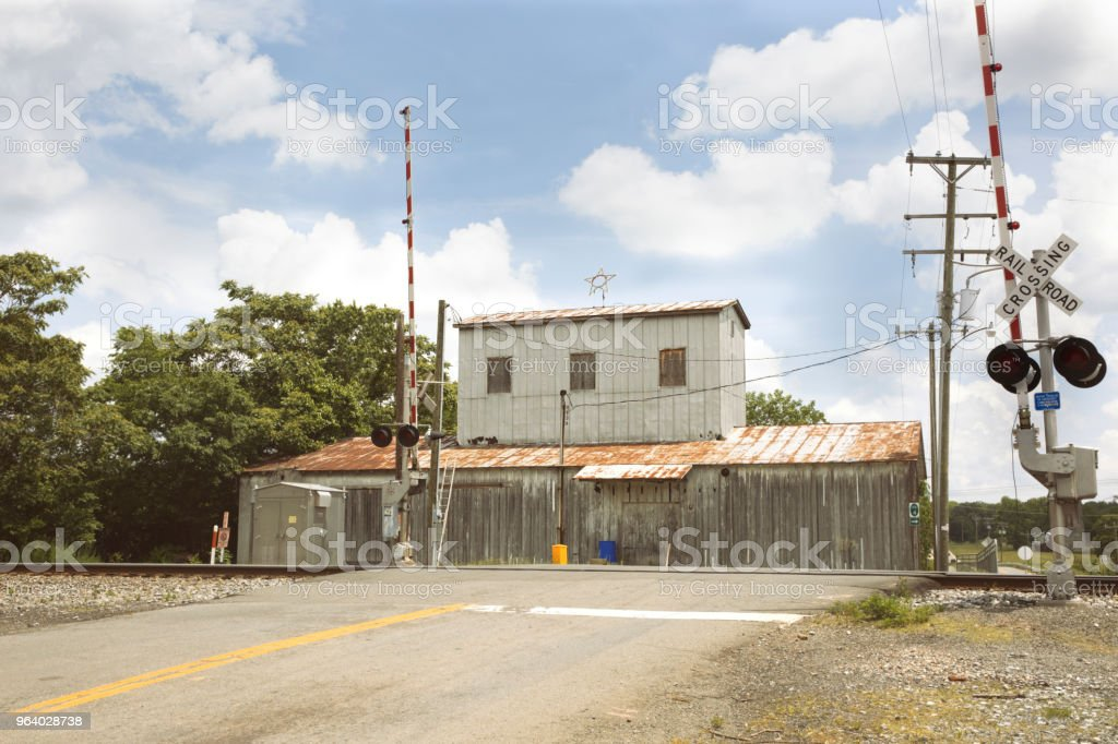 Railroad crossing in Remington Virginia Main Street with blue sky and clouds - Royalty-free Blue Stock Photo