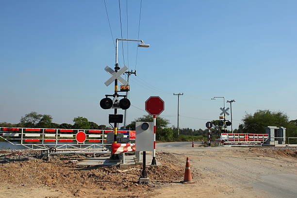 railroad crossing - railway signal stock photos and pictures