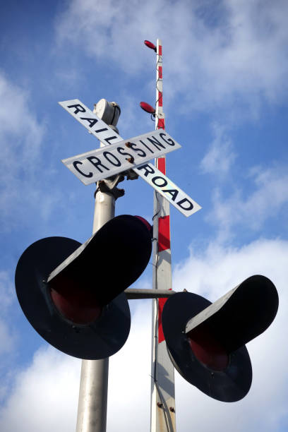 railroad crossing sign - railway signal stock photos and pictures