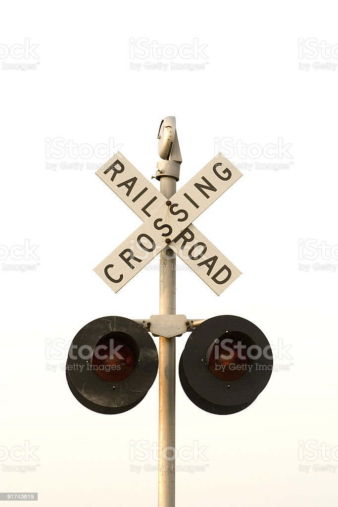 Railroad crossing sign with lights - white background stock photo