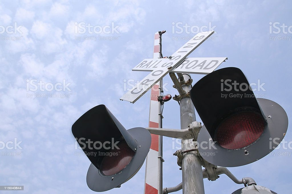 Railroad Crossing Signal Gate Lights with a Blue Sky royalty-free stock photo
