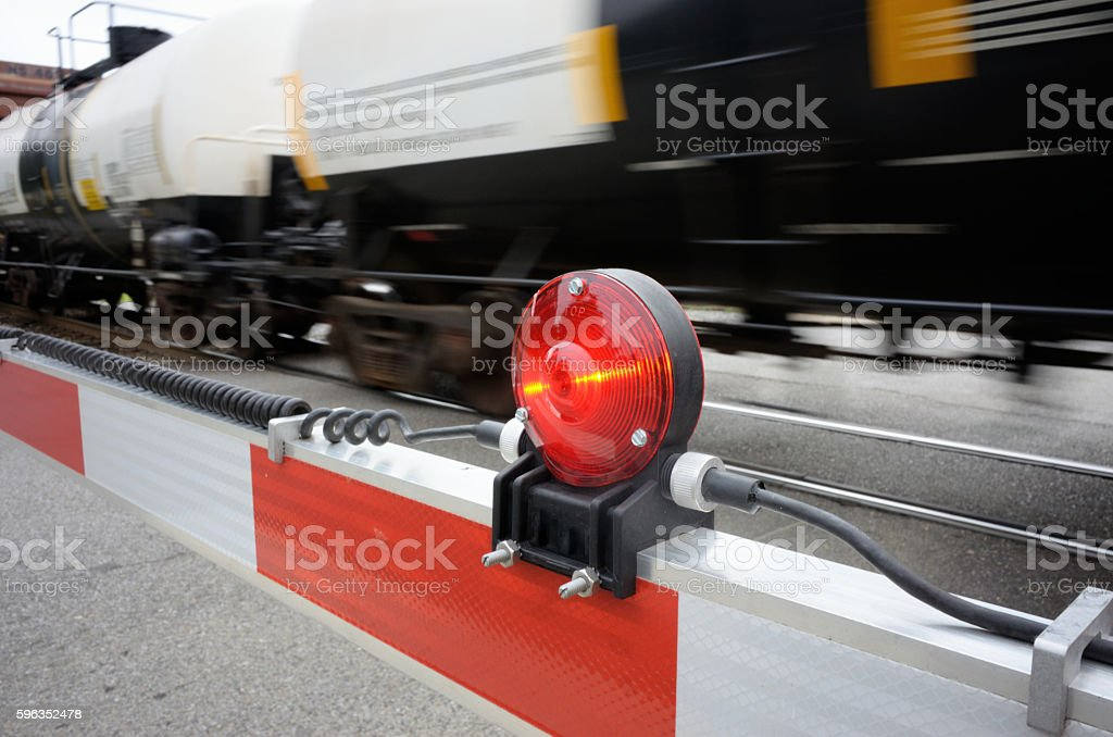 Railroad crossing with train royalty-free stock photo