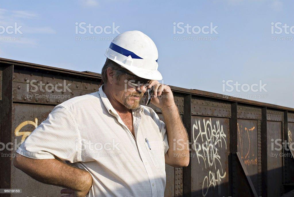 Railroad Engineer on Phone royalty-free stock photo