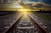 railroad for transportation with sunlight and silhouette, dark tone transport railway, concept the way to go  to the target