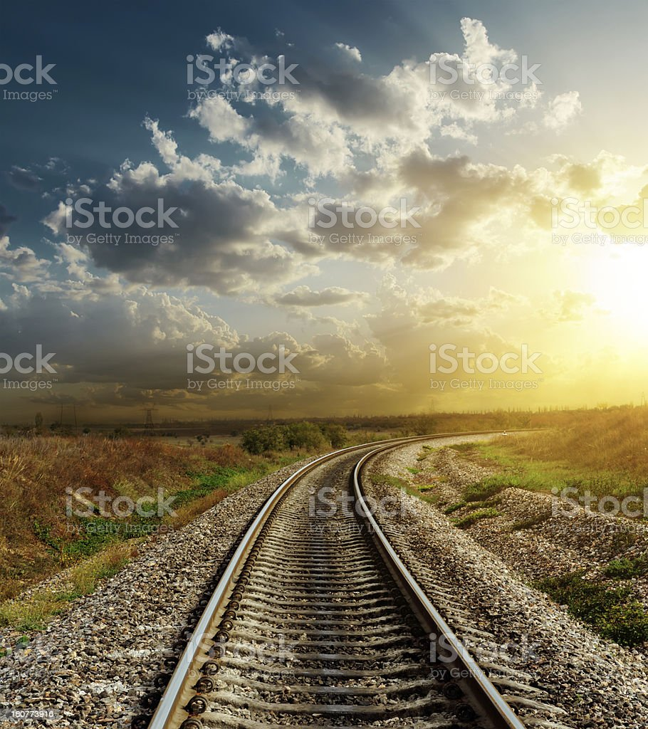 railroad goes to horizon in sunset stock photo