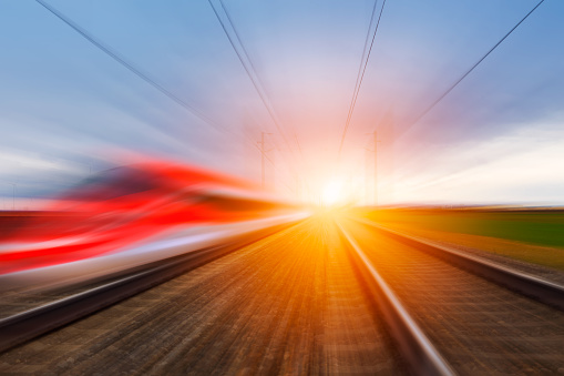 Railroad In Motion At Sunset Stock Photo - Download Image Now