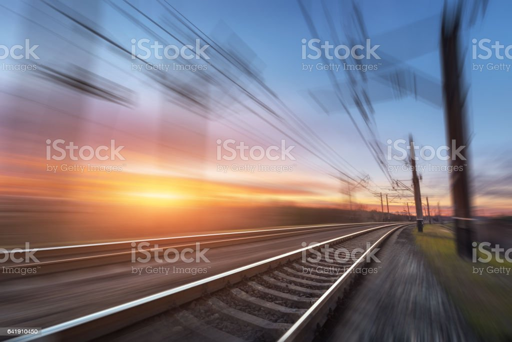 Railroad in motion at sunset. Railway station stock photo