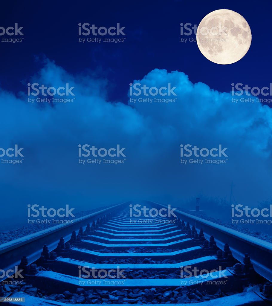 railroad in night under clouds with full moon Lizenzfreies stock-foto