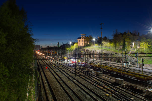 A railroad junction during night time stock photo