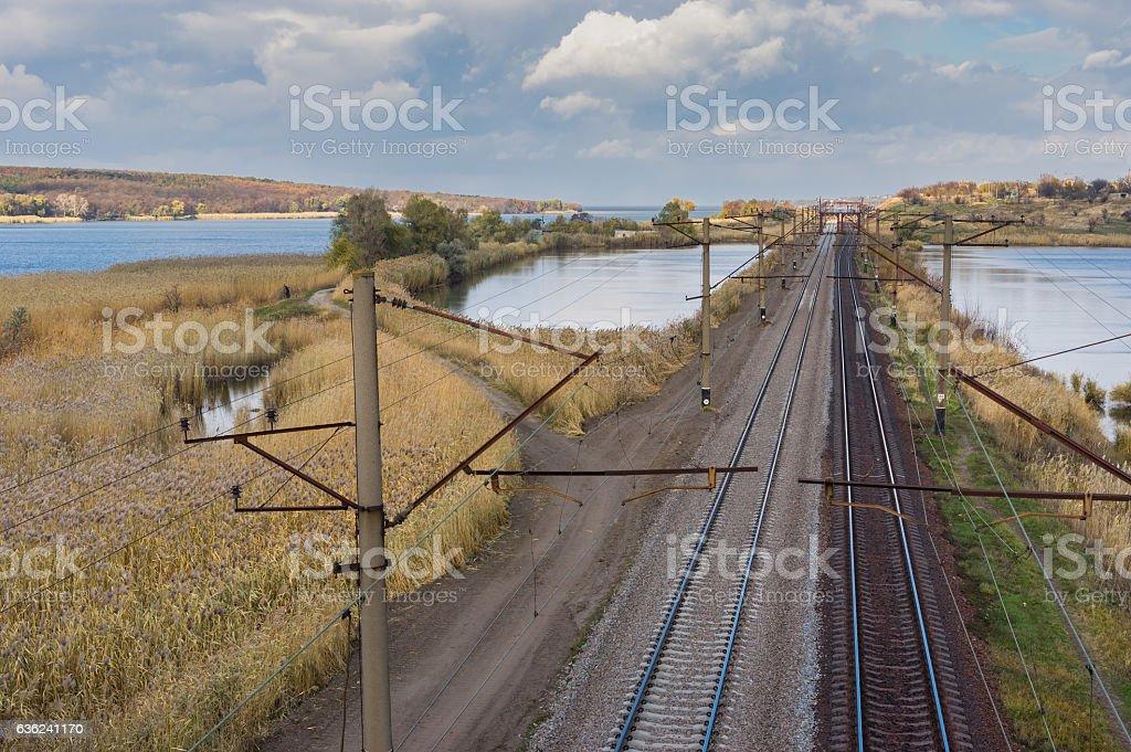 Railroad landscape at fall season in central Ukraine stock photo