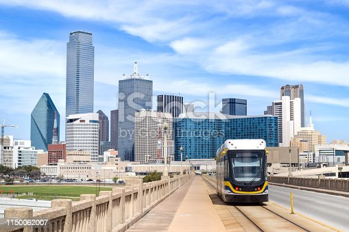 Tram (Metro Train) on Elevated Highway in front of the Dallas Skyline - Dallas, Texas, USA