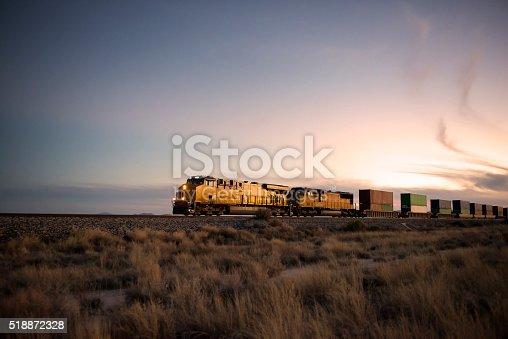 istock Railroad locomotive at dusk 518872328