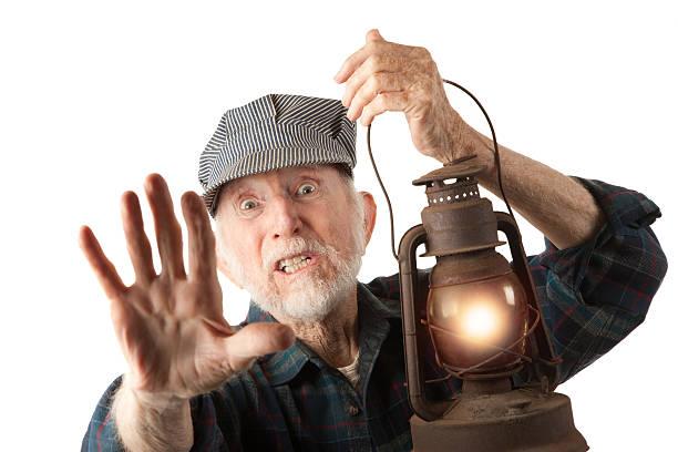 kolej człowiek gospodarstwa lampion - konduktor pociągu zdjęcia i obrazy z banku zdjęć