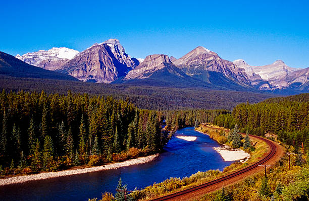 Railroad Railroad on the riverbanks to Bow River high seat stock pictures, royalty-free photos & images