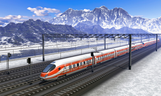 Railroad station in mountains with high speed train