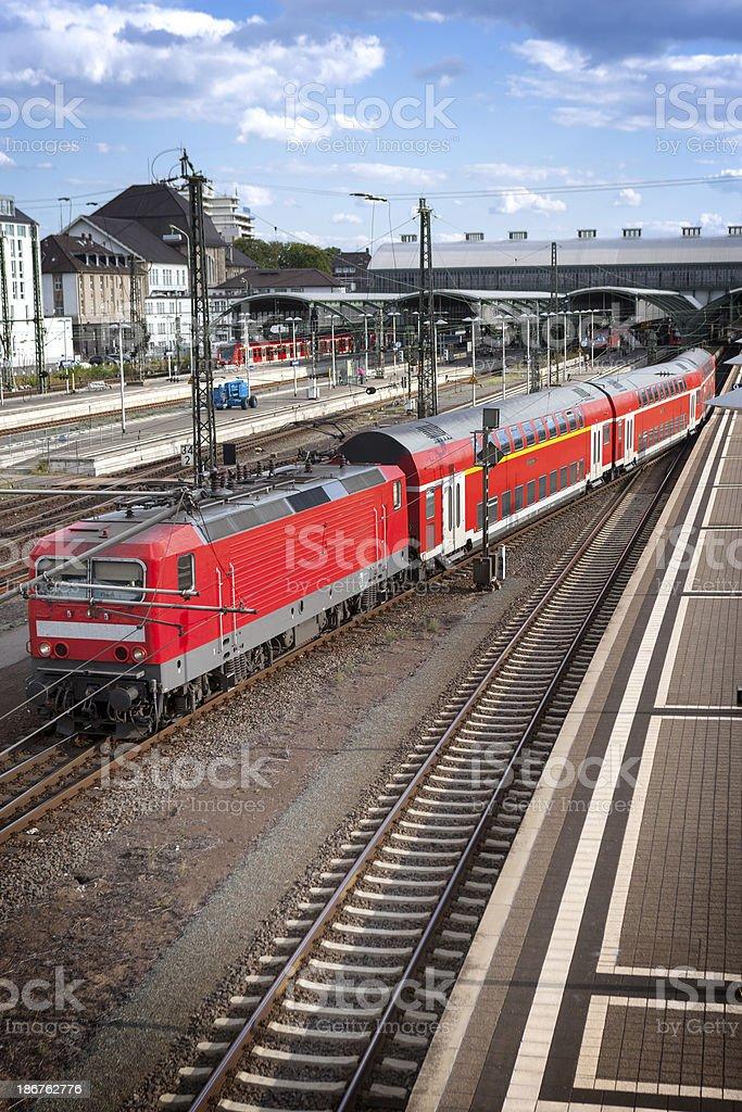 Railroad station platform, leaving train royalty-free stock photo