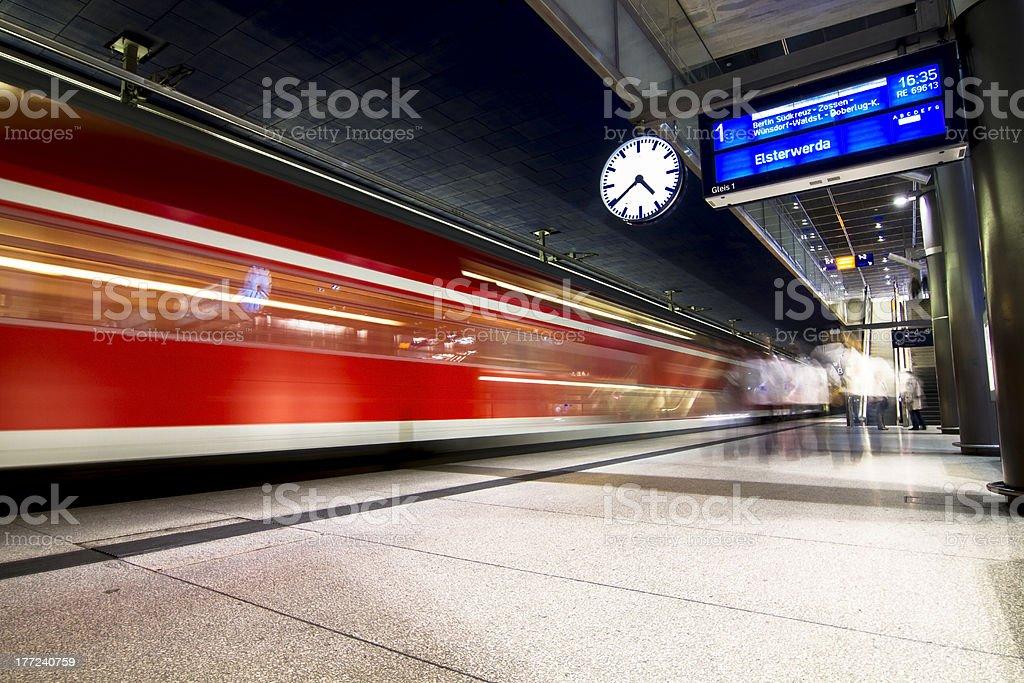 Railroad Station platform with departing Train