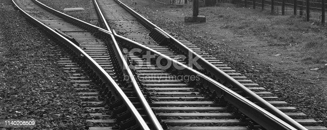 Railroad with track switch near a station in The Netherlands.