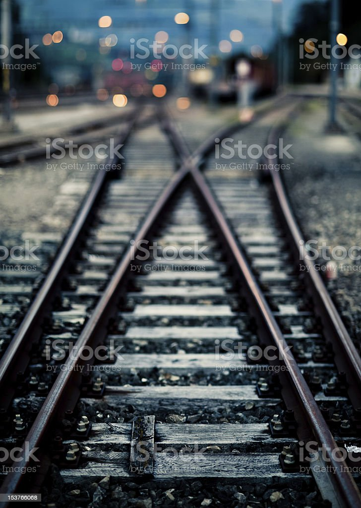 Railroad switch in the evening stock photo