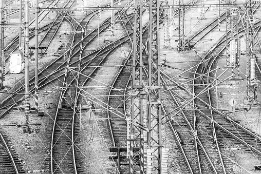Railroad tangle at large train station. Railway transportation theme. Black and white image.