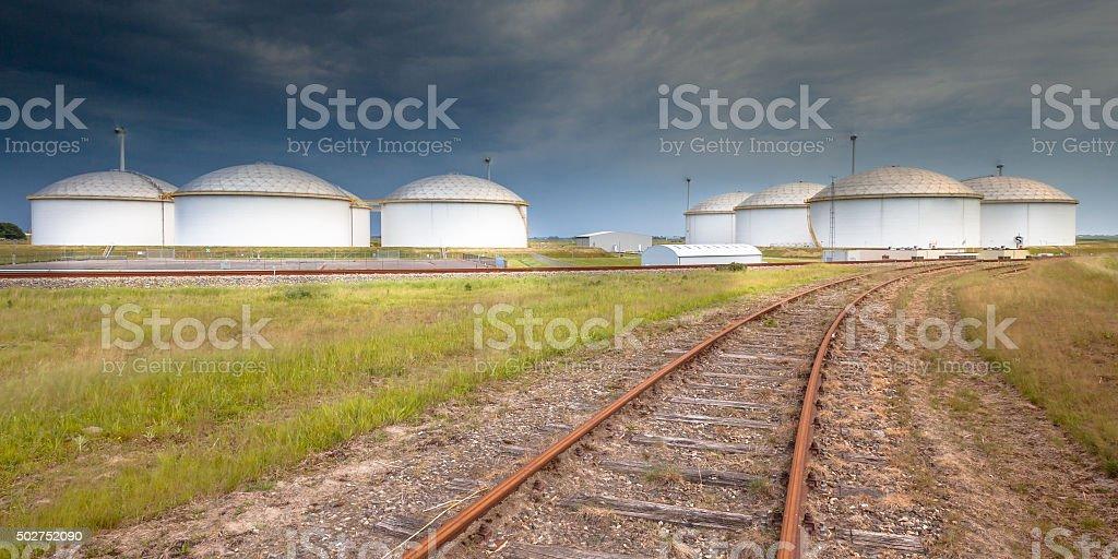 Railroad to a giant oil tank terminal stock photo