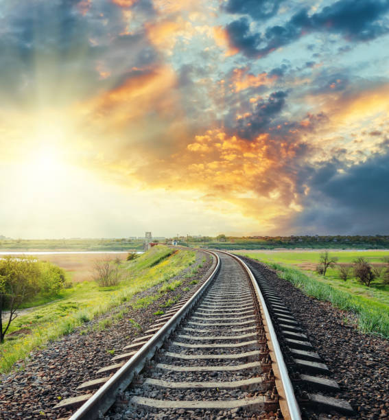 railroad to horizon in colored sunset railroad to horizon in colored sunset tramway stock pictures, royalty-free photos & images